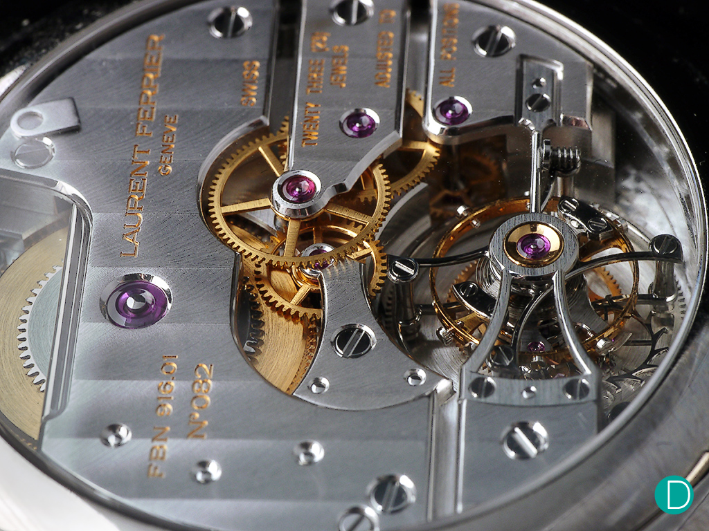 The movement. Remains the same as the one found in the first Galet Tourbillon. The movement is round in a square/cushioned shaped case.