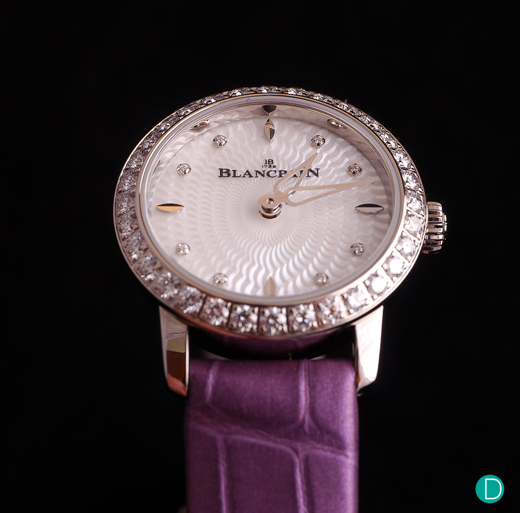 This limited edition come in a white gold case and features a bezel set with a row of 32 diamonds.